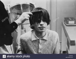 mick jagger of the rolling stones having a haircut at bbc tv