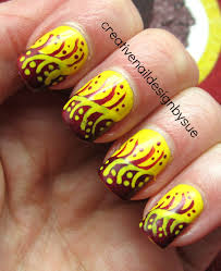 creative nail design by sue fall into autumn challenge football