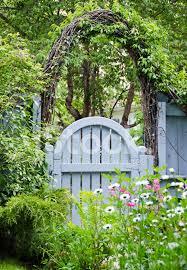 blue garden gate and spring flowers stock photos freeimages com