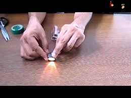 science electricity experiment with torch and circuit