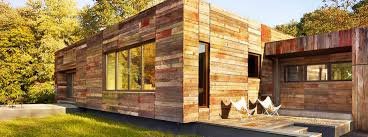 vernacular inspired delaware home built with recycled barn wood