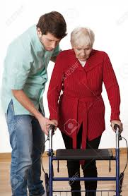 elder walker teaching elder disabled person how to walk with walker stock