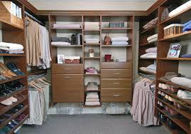 trendy interior walk in closet design with white storage also