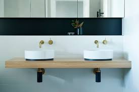 jane ledger interiors interior design studio bathroom design at the moment for example brushed brass and black fixtures a beautiful artisan tile a feature pendant a custom drawer handle