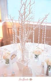 white manzanita tree centerpieces with hanging crystals included