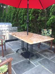 Patio Table Bases A Custom Granite Patio Table With Our Bruni 2 X 2 Black Cast Iron