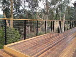 modern deck railing using cable angle iron and wood deck
