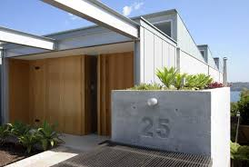 exterior design address numbers and corrugated metal roofing also
