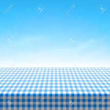 empty picnic table covered with blue checkered tablecloth royalty
