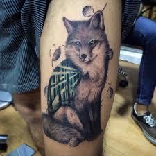 2 grey ink fox tattoos for