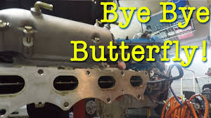 removing the butterfly from the intake manifold on the boosted