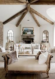 shabby chic livingroom chaise lounge and wooden beams inside the lovely shabby