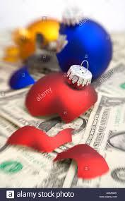 closeup of three broken tree bulb ornaments on dollar
