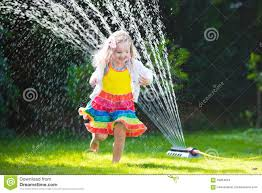 kids playing with garden sprinkler stock photo image 59264634