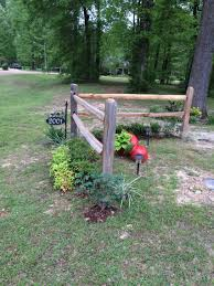 corner accent fence by next year the running roses and clematis