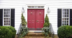 the perfect red front door this colonial style home features a
