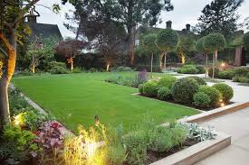 sandbox hexagon step stone barrel planter green grass patio slab