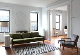 mid century eclectic living room grey tuxedo sofa white hairy rug
