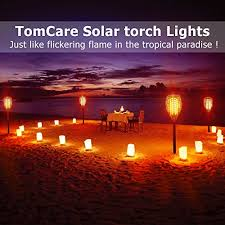 tomcare solar lights waterproof flickering flames torches lights