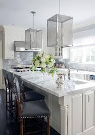 gray kitchen cabinets with white marble countertops ivory and gray kitchen features ivory cabinets paired with