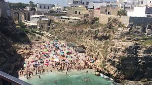 Cliffside Restaurant Italy by The Beach And Cliffs Polignano A Mare Italy Youtube