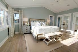 steely light blue bedroom walls wide plank rustic wood floors