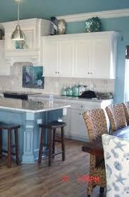 Nautical Kitchen Cabinets Coastal Decor White Cabinets And Warm Wood Floor
