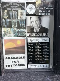 a tattoo shop in my town has a strong advertisement game meme guy