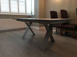 scratch resistant dining table large xenon ceramic top extendable dining table sturdy and scratch