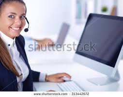 Sitting On The Desk Happy Female Wearing Headset Sitting On Stock Photo 539192131
