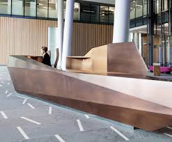 Metal Reception Desk Bespoke Geometric Reception Desk Clad In Gilding Metal Benchmark