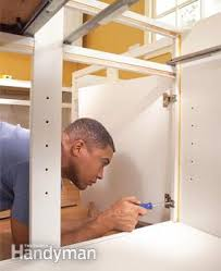 Install Wall Cabinets How To Install Kitchen Cabinets Family Handyman