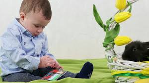 easter plays for children boy child plays smartphone kid