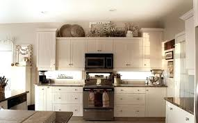 ideas for top of kitchen cabinets best top of kitchen cabinet decorating ideas photos liltigertoo