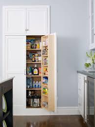 large white kitchen storage cabinet inset pantry contemporary kitchen bhg