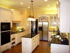 yellow kitchen walls white cabinets hausratversicherungkosten charming yellow kitchen white