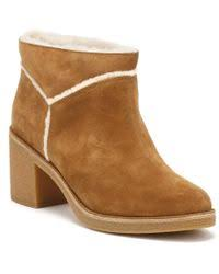womens ugg plumdale boots lyst ugg chestnut plumdale tasseled fur boots in brown