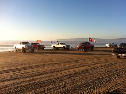 native plants grow on the sand dunes at this beach stock photo big trucks at the oceano dunes cali style pismo beach and avila