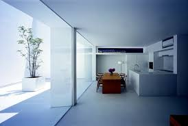 minimalist house design in white with monolithic construction