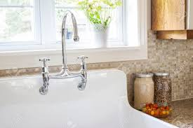 backsplash kitchen sink with granite shaped tile countertops