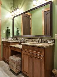 retro bathroom with green tiles and whote vanity cabinets retro