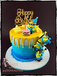 minions cake toppers minion birthday cake with tower of fondant minions yellow