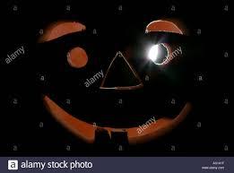 a halloween pumpkin lantern in clay illuminated stock photo