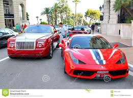 roll royce red rolls royce drophead coupe and ferrari 458 italia speciale