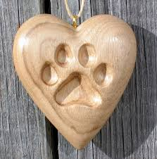 paw print wood carving or cat ornament carved