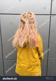 accessorize hair stylish boho hairstyle on pink hair stock photo 747278797