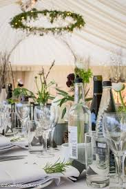 New Year S Eve Table Decorations Uk by Marquee Table Centres Over Looking A Hanging Floral Ring And Arch