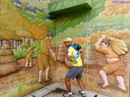 ahpek biker old dog rides again cycling korea 2016 day 12 there are relics from the old houses of the village here on display farming equipment etc on the walls of the compound were large murals depicting
