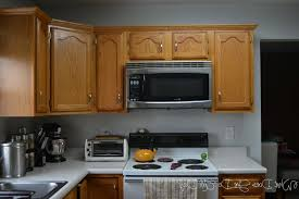Kitchen Paint With Oak Cabinets by White Granite Countertop Brown Wood Paint Cabinets Design Gray