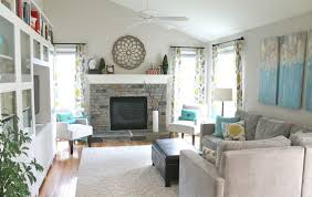 white wall color with stone fireplace for cozy family room design